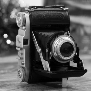 Black and white photograph of Milly's Cameras 1950's Balda Baldix medium format film camera taken by Darron Barnes