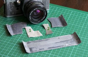 Removed old camera skins from a Praktica MTL 3 film camera