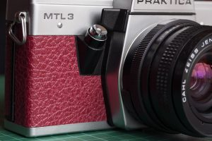 Recovered Praktica MTL 3 SLR film camera front view with new crisp cut replacement camera leather. By Millys Cameras