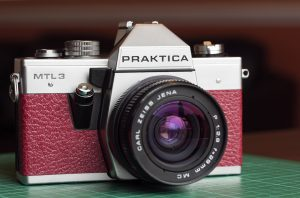 Praktica MTL3 Film Camera Recovered in a burgundy leather from Milly's Camera