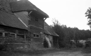 A lack and white photograph taken with voigtlander vito 1 film camera. Photograph of front of a barn wickham hampshire area