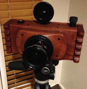 A photograph of FAC Mark II panoramic film camera finished and on a tripod. By Lee Lira.