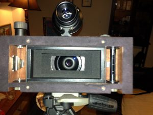 Photograph showing inside the film chamber of the Fac mark II panoramic film camera. Made by Lee Lira.