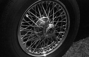 Vintage car chrome spoke wheel black and white photograph taken with Ashi Pentax Spotmatic SP with Carl Zeiss Pancola 50mm 1:8 lens